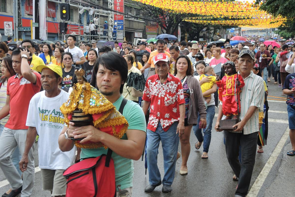 Devotees carry their own images of Santo Niño, which vary considerably.