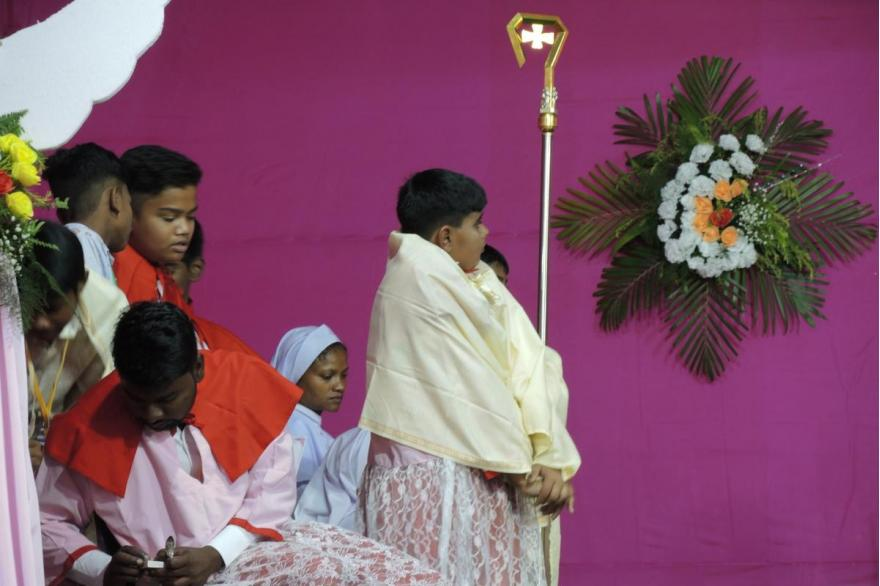 Bishop's crozier held by an acolyte during the Mass for Dhori Mata.