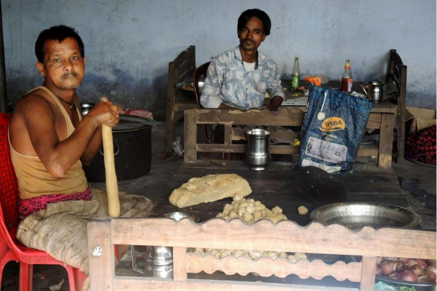 Preparing fried flat bread to serve to the tens of thousands of devotees who come for the feast of Dhori Mata.