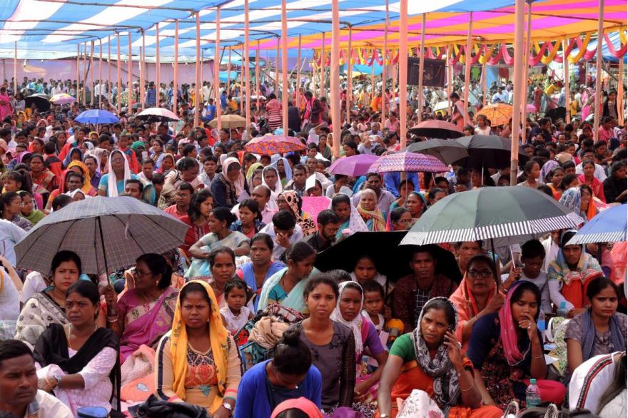 Devotees are seated under tents for the Mass for Dhori Mata.