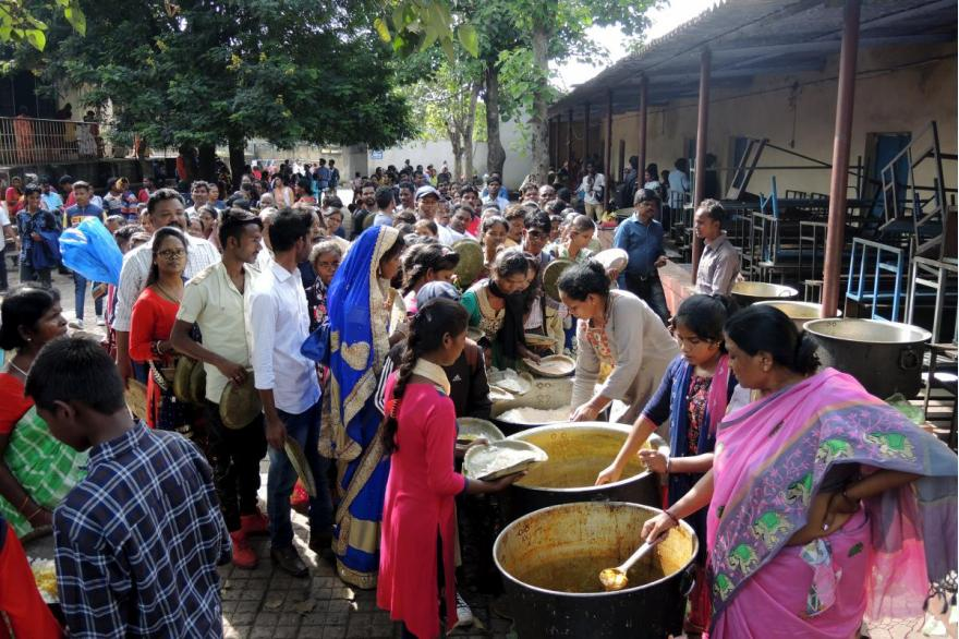Vegetables and rice are served to pilgrims who come for the feast of Dhori Mata.