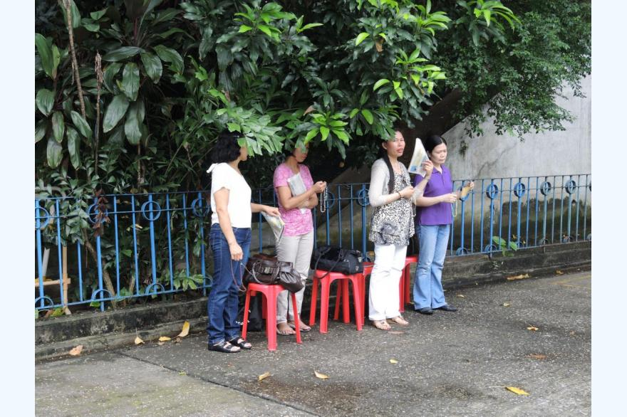 Praying near the grotto, St. Joseph's Church, Hong Kong