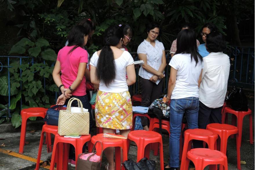 Prayer group outside St. Joseph's Church, Hong Kong